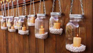 Velas con frascos de vidrio reciclados